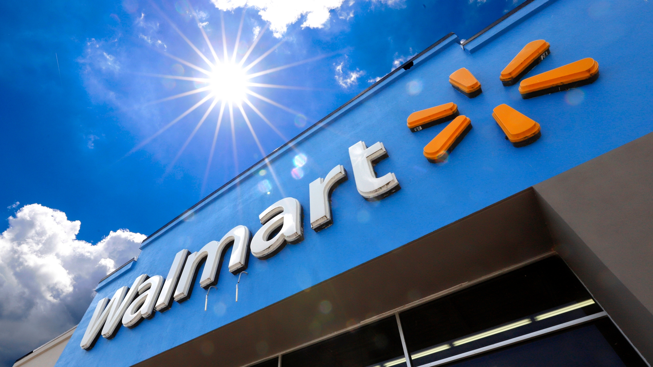 This June 25, 2019, file photo shows the entrance to a Walmart in Pittsburgh. Walmart is spreading out its traditional one-day Black Friday deals over three weekends in November 2020 in an effort to reduce crowds in its stores amid the coronavirus pandemic. (AP Photo/Gene J. Puskar, File)