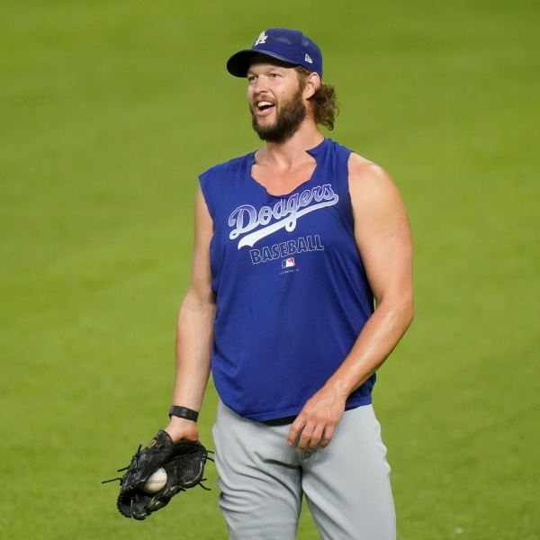 Los Angeles Dodgers starting pitcher Clayton Kershaw works out before Game 3 of the National League Championship Series against the Atlanta Braves on Oct. 14, 2020, in Arlington, Texas. (Eric Gay / Associated Press)
