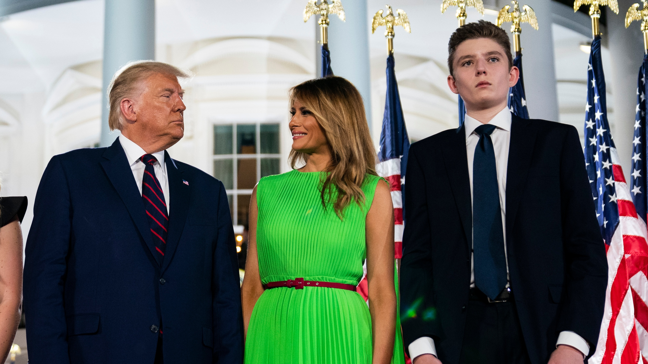 In this Aug. 27, 2020 file photo, Barron Trump right, stands with President Donald Trump and first lady Melania Trump on the South Lawn of the White House during the Republican National Convention (Evan Vucci/Associated Press)