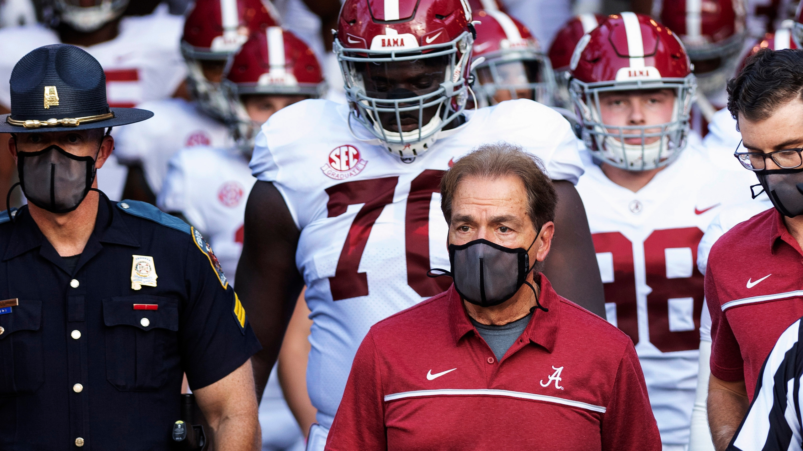 Alabama coach Nick Saban leads his team to the field before an NCAA college football game against Missouri in Columbia, Missouri, on Sept. 26, 2020. (L.G. Patterson / Associated Press)