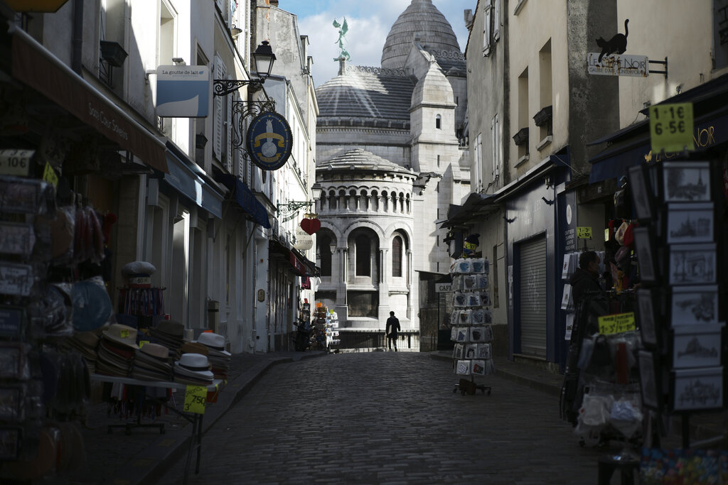 Tourists shops are empty in a deserted street just outside the Sacre Coeur basilica in the Montmartre district of Paris on Oct. 15, 2020. (AP Photo/Lewis Joly)