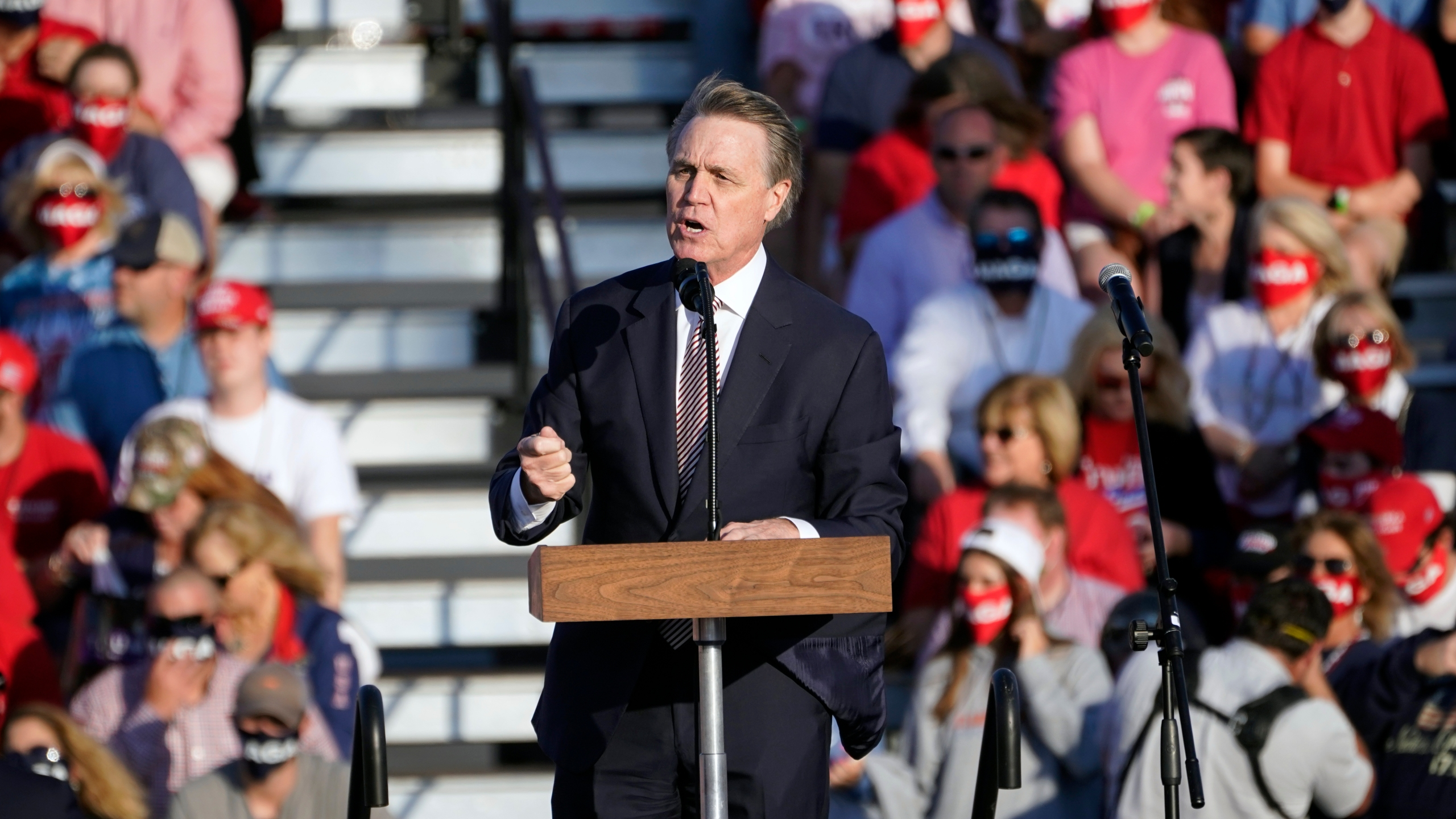 Sen. David Perdue of Georgia speaks during a campaign rally for President Donald Trump at Middle Georgia Regional Airport in Macon on Oct. 16, 2020. (John Bazemore / Associated Press)