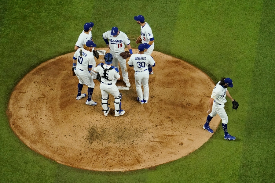 Los Angeles Dodgers starting pitcher Tony Gonsolin leaves the game against the Atlanta Braves during the fourth inning in Game 7 of a baseball National League Championship Series on Oct. 18, 2020, in Arlington, Texas. (David J. Phillip / Associated Press)