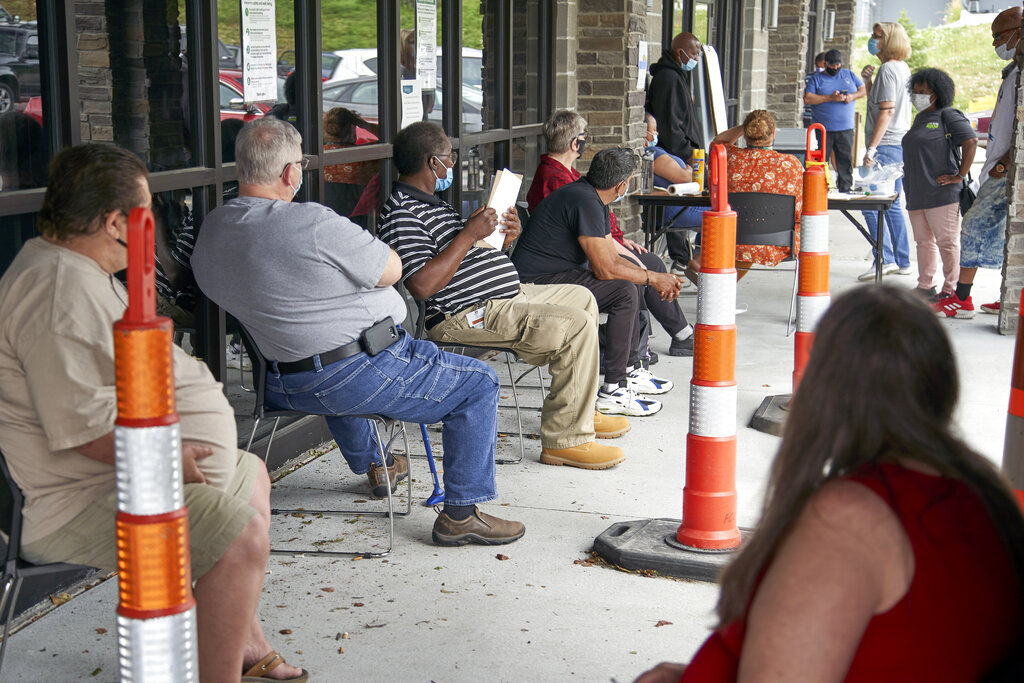 In this July 15, 2020, file photo, job seekers exercise social distancing as they wait to be called into the Heartland Workforce Solutions office in Omaha, Neb. (AP Photo/Nati Harnik, File)