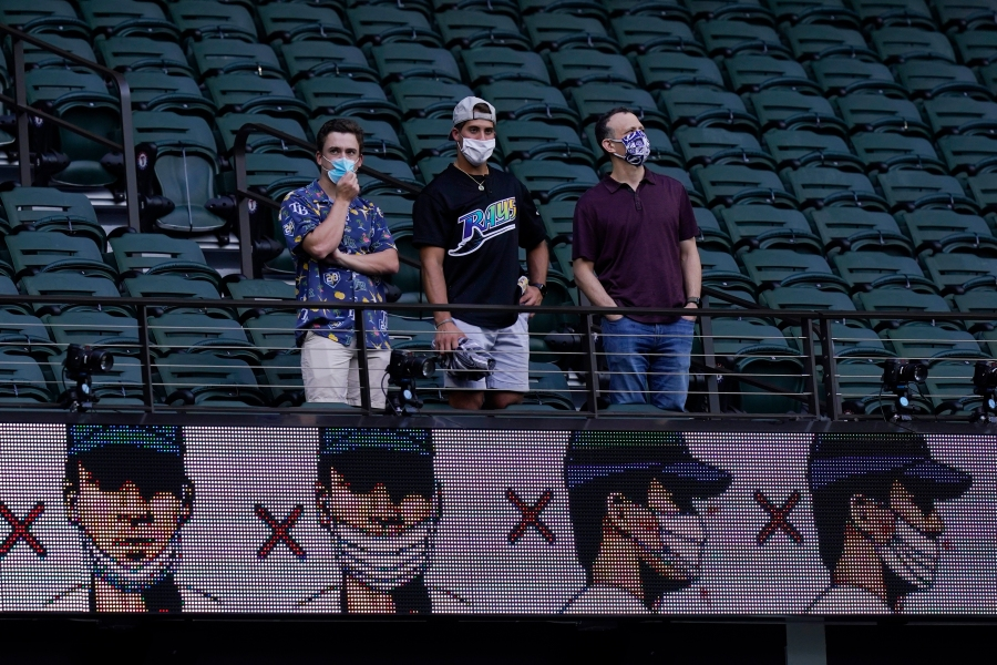 Fans watch batting practice before Game 1 of the baseball World Series between the Los Angeles Dodgers and the Tampa Bay Rays on Oct. 20, 2020, in Arlington, Texas. (AP Photo/Eric Gay)
