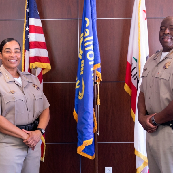 This photo provided by the California Highway Patrol shows CHP Commissioner Warren Stanley, right poses for a photo with Deputy Commissioner Amanda Ray after an announcement of Stanley's retirement and Ray's appointment to Commissioner on Oct. 20, 2020, in Sacramento, (California Highway Patrol via AP)