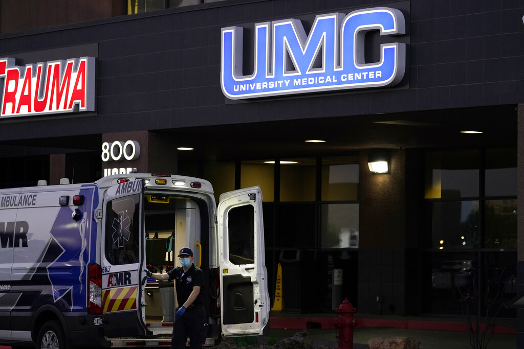 An ambulance is parked at the University Medical Center in Las Vegas on Oct. 12, 2020. Spikes of the coronavirus are hitting spots around the United States, forcing public health officials to scramble to ensure there are enough hospital beds to accommodate the sick. (AP Photo/John Locher)