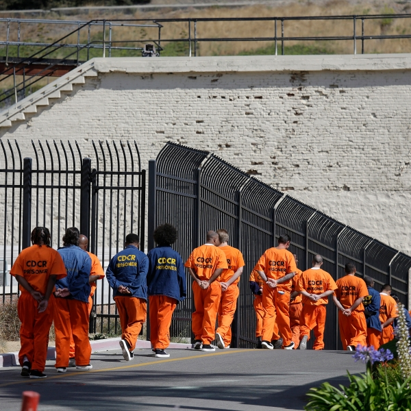 In this Aug. 16, 2016, file photo, general population inmates walk in a line at California's San Quentin State Prison. (AP Photo/Eric Risberg, File)