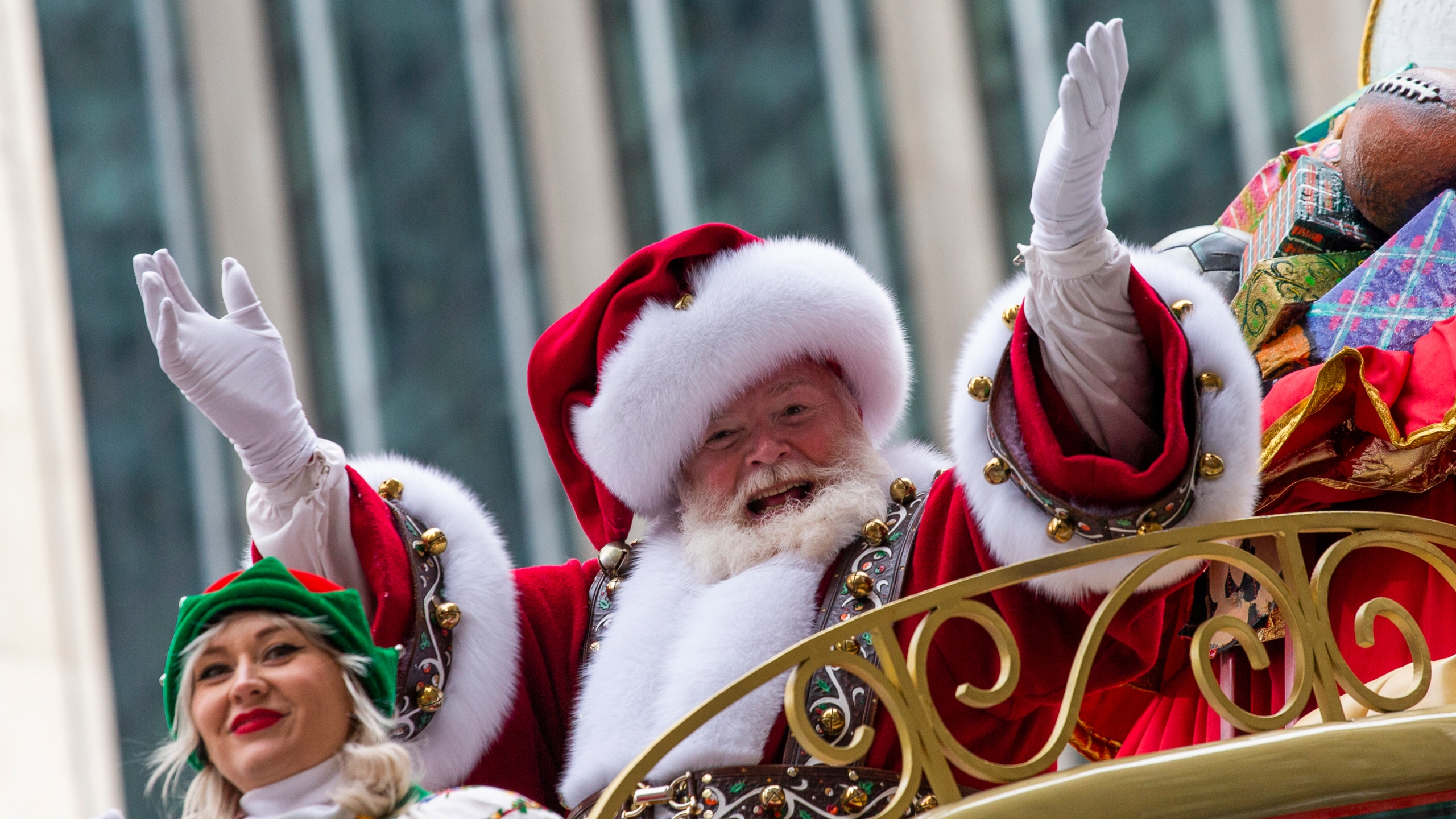 Santa Claus waves during the Macy's Thanksgiving Day Parade, Nov. 28, 2019, in New York. Macy's said Santa Claus won't be greeting kids at its flagship New York store this year due to the coronavirus, interrupting a holiday tradition started nearly 160 years ago. However, Macy's said the jolly old man will still appear at the end of the televised Macy's Thanksgiving Day parade. (AP Photo/Eduardo Munoz Alvarez, File)