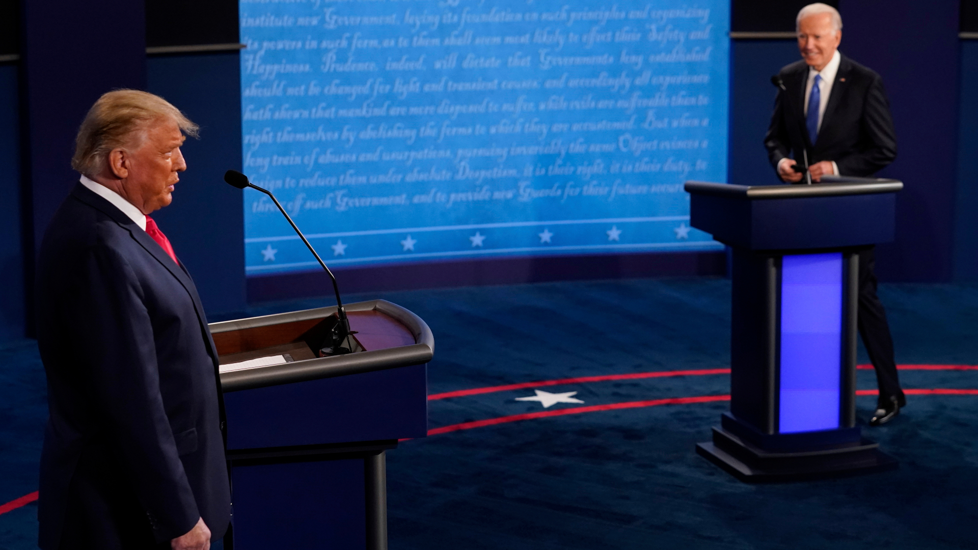 President Donald Trump and Democratic presidential candidate former Vice President Joe Biden walk on stage during the second and final presidential debate at Belmont University in Nashville, Tennessee, on Oct. 22, 2020. (Morry Gash / Associated Press)