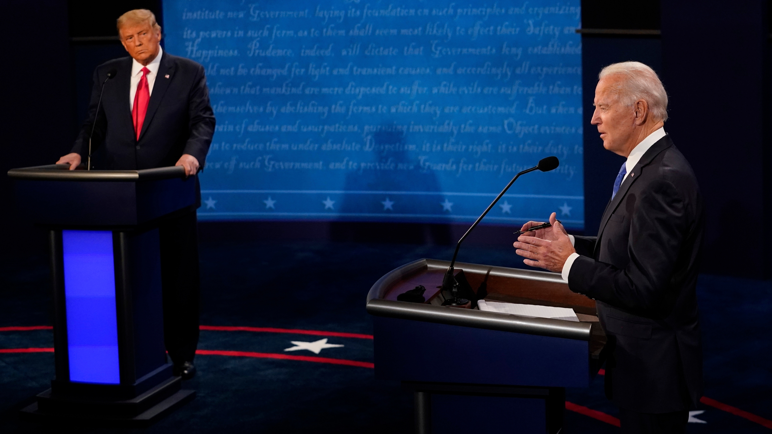 Democratic presidential candidate former Vice President Joe Biden answers a question as President Donald Trump listens during the second and final presidential debate Oct. 22, 2020, at Belmont University in Nashville, Tennessee. (Morry Gash / Associated Press)