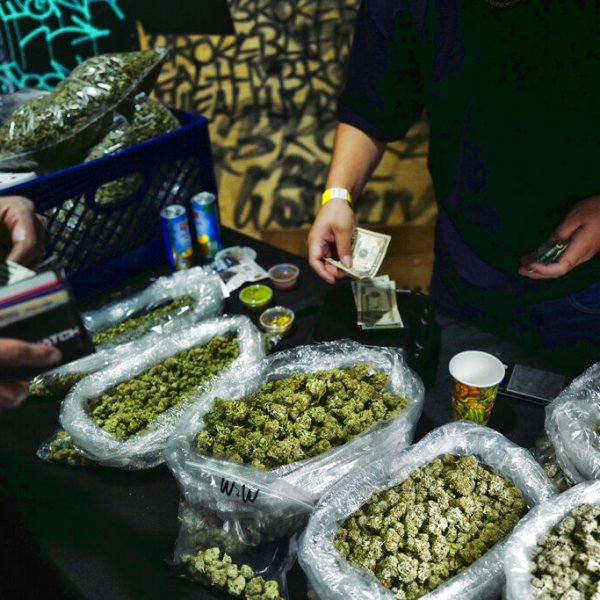 In this April 15, 2019, file photo, a vendor makes change for a marijuana customer at a cannabis marketplace in Los Angeles. (AP Photo/Richard Vogel, File)