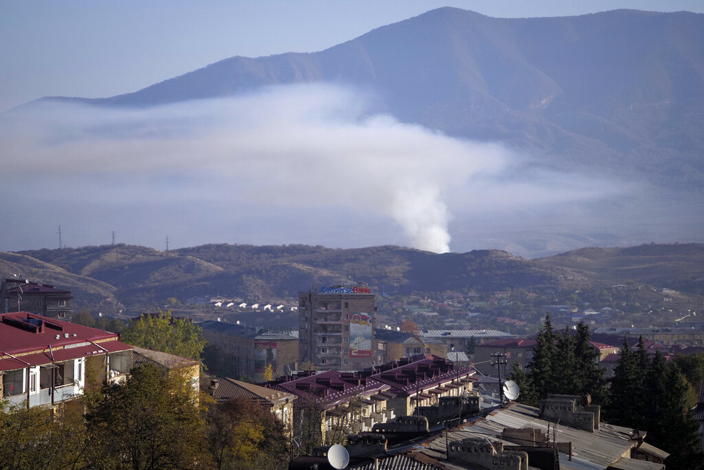 Smoke rises after shelling by Azerbaijan's artillery during a military conflict in Stepanakert, the separatist region of Nagorno-Karabakh on Oct. 24, 2020. (AP Photo)