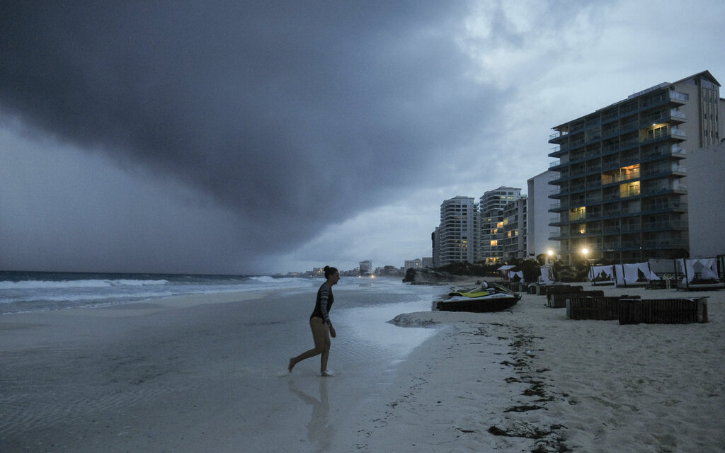 Clouds gather over Playa Gaviota Azul as Tropical Storm Zeta approaches Cancun, Mexico, Monday, Oct. 26, 2020. (AP Photo/Victor Ruiz Garcia)