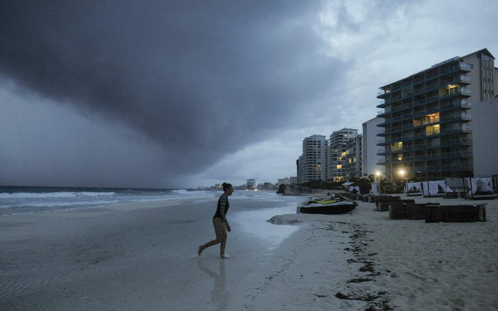 Clouds gather over Playa Gaviota Azul as Tropical Storm Zeta approaches Cancun, Mexico, Monday, Oct. 26, 2020. (AP Photo/Victor Ruiz Garcia)