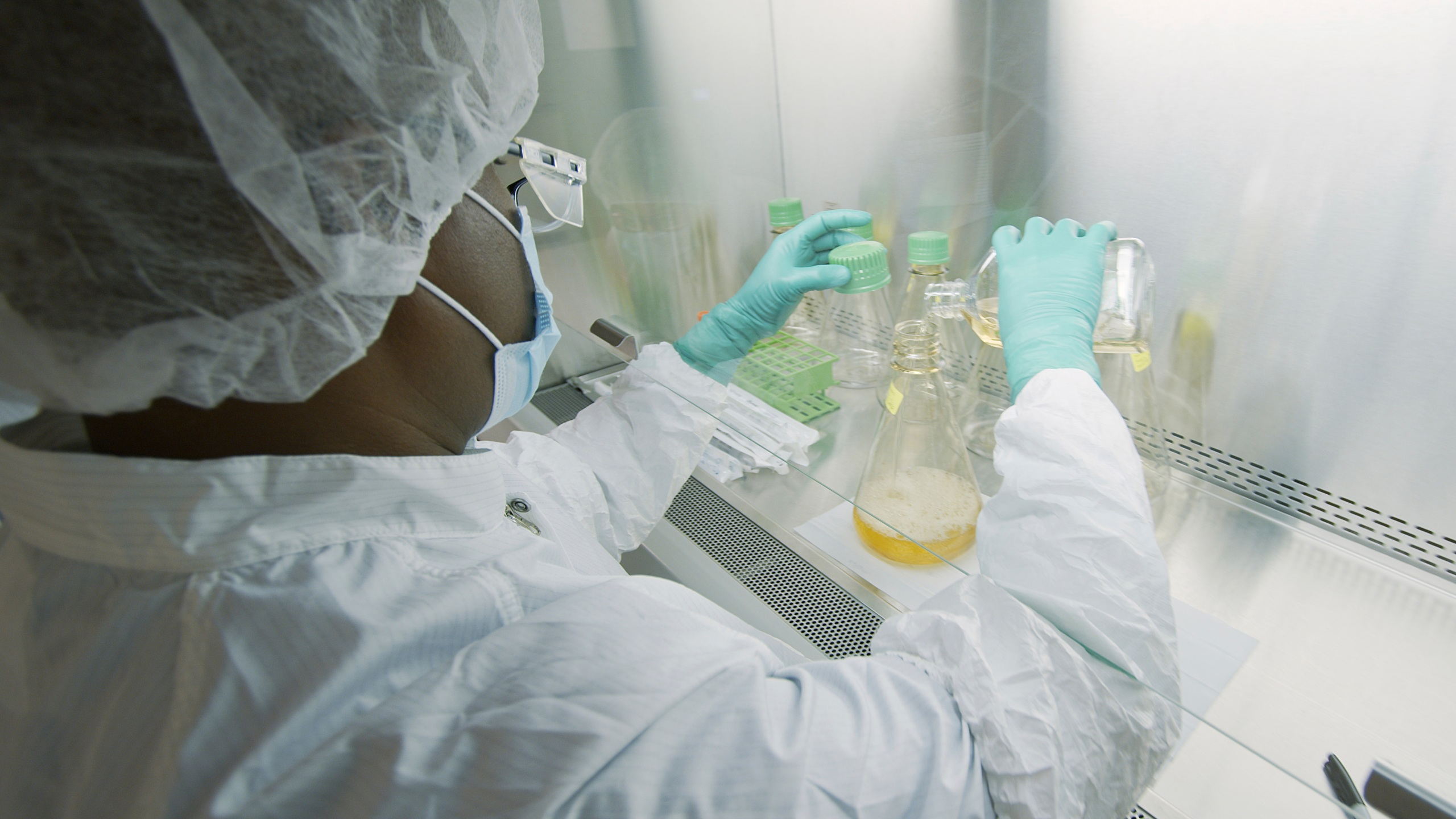 In this May 2020 file photo provided by Eli Lilly, a researcher tests possible COVID-19 antibodies in a laboratory in Indianapolis. (David Morrison/Eli Lilly via AP)