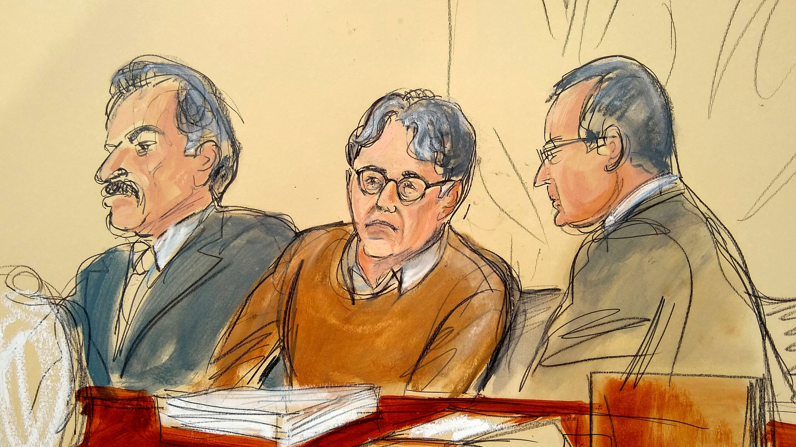 In this Tuesday, May 7, 2019, file courtroom drawing, defendant Keith Raniere, center, leader of the secretive group NXIVM, is seated between his attorneys Paul DerOhannesian, left, and Marc Agnifilo during the first day of his sex trafficking trial. Raniere, a self-improvement guru whose organization NXIVM attracted millionaires and actresses among its adherents was sentenced to 120 years in prison on Oct. 27, 2020.(Elizabeth Williams via Associated Press)