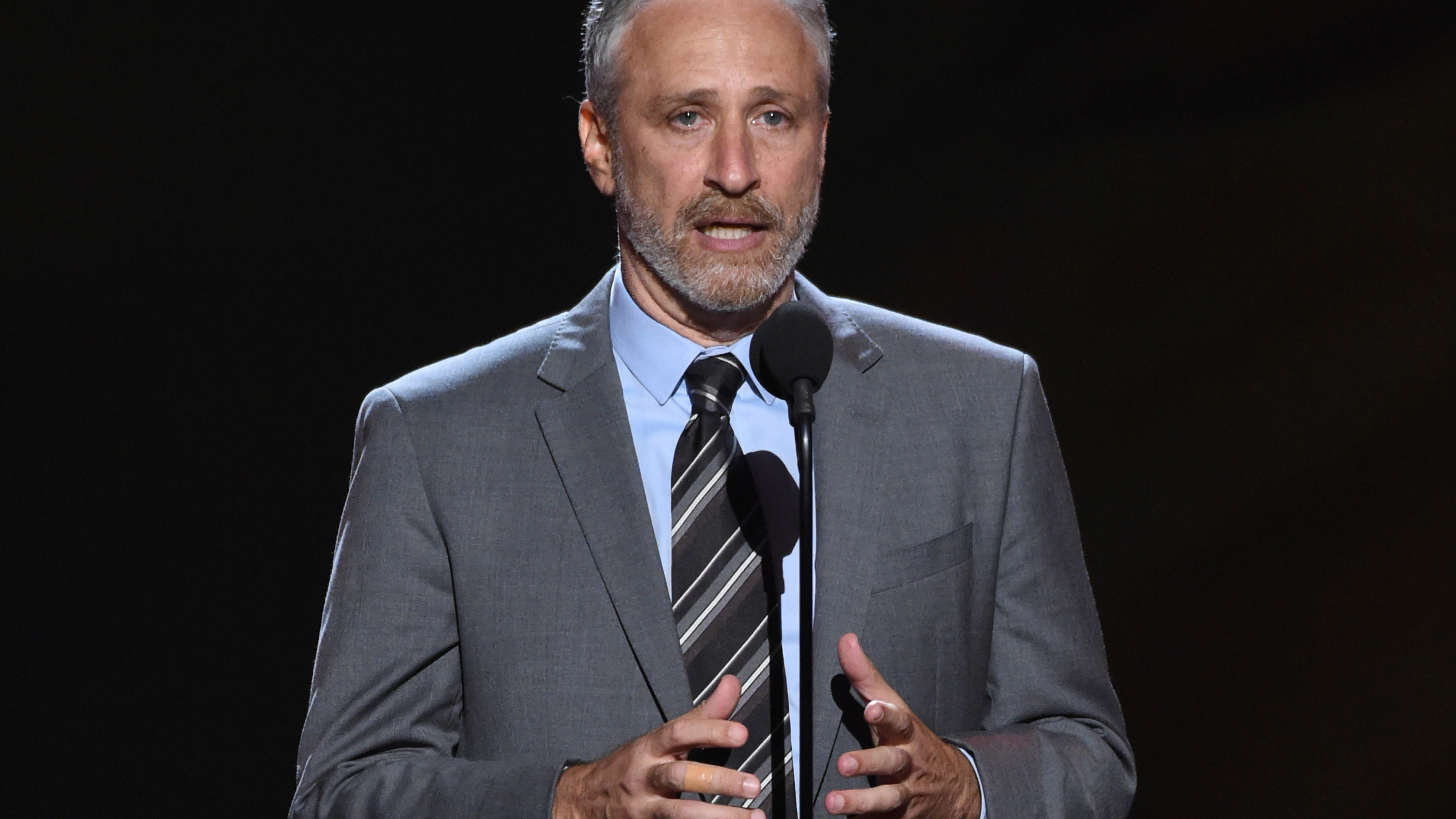 Jon Stewart presents the Pat Tillman award for service on July 18, 2018, at the ESPY Awards in Los Angeles. (Phil McCarten/Invision/AP, File)