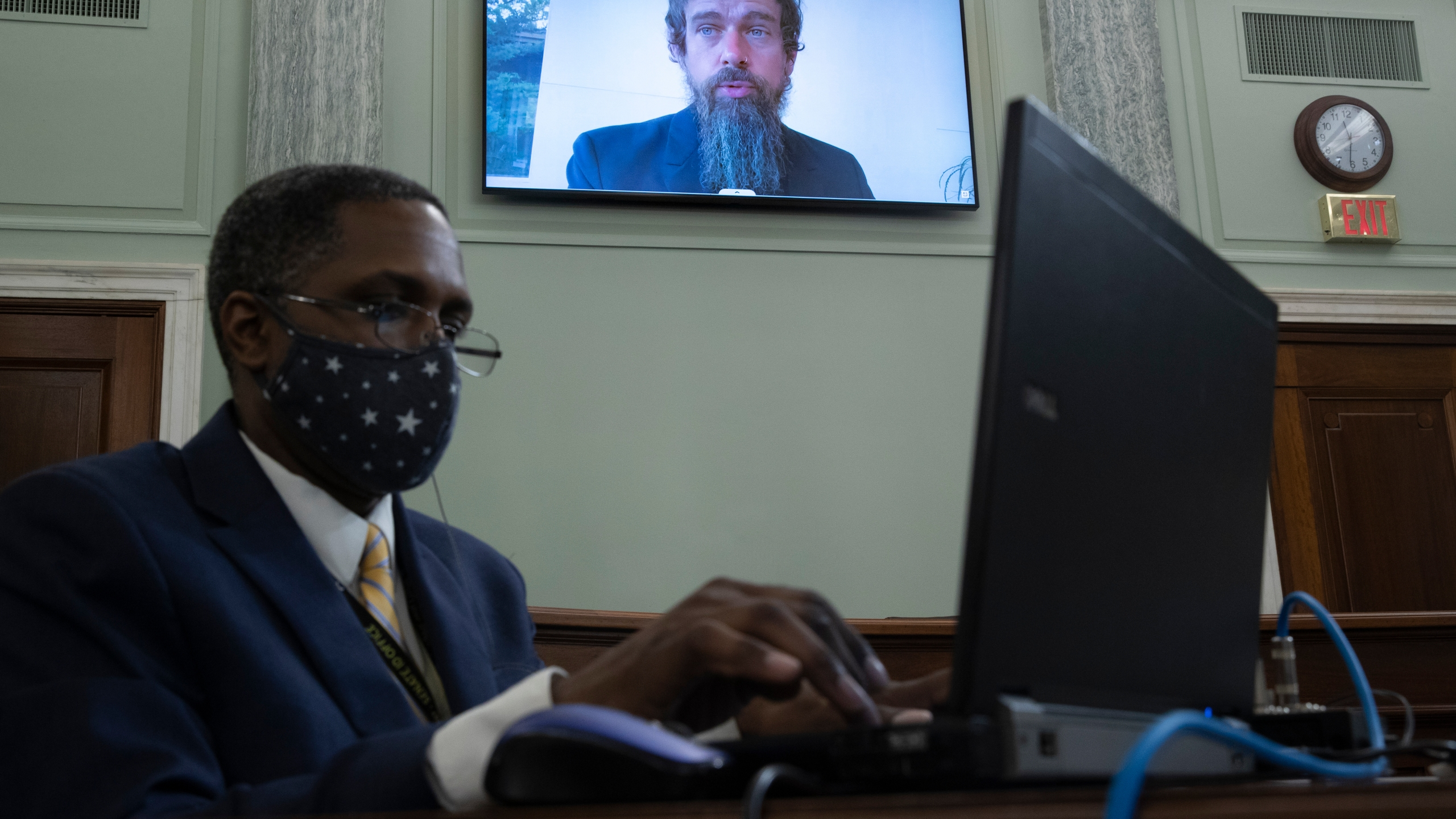 Twitter CEO Jack Dorsey appears on a screen as he speaks remotely during a hearing before the Senate Commerce Committee on Oct. 28, 2020. (Michael Reynolds/Pool via Associated Press)