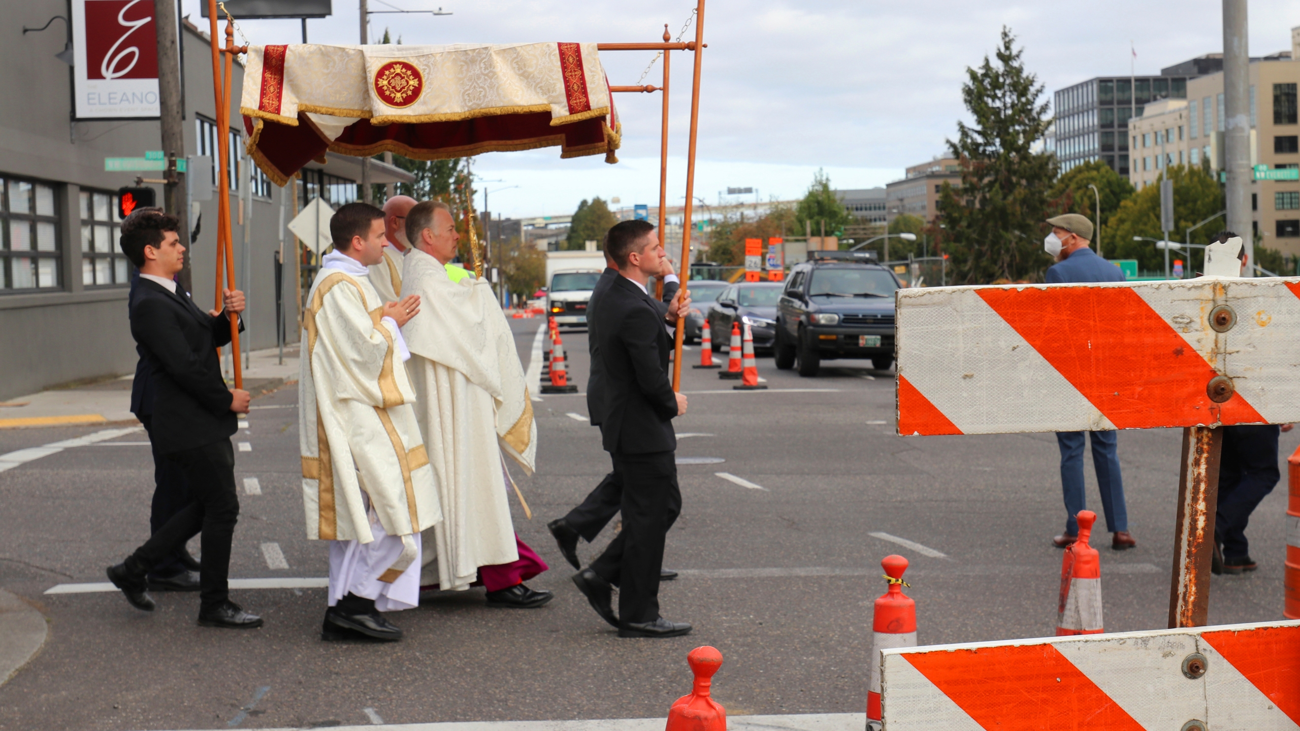 Archbishop Alexander Sample carries the Eucharist into downtown Portland, Ore., for an exorcism and rosary to bring peace and justice to the city on Oct. 17, 2020. (Ed Langlois/Catholic Sentinel via AP)