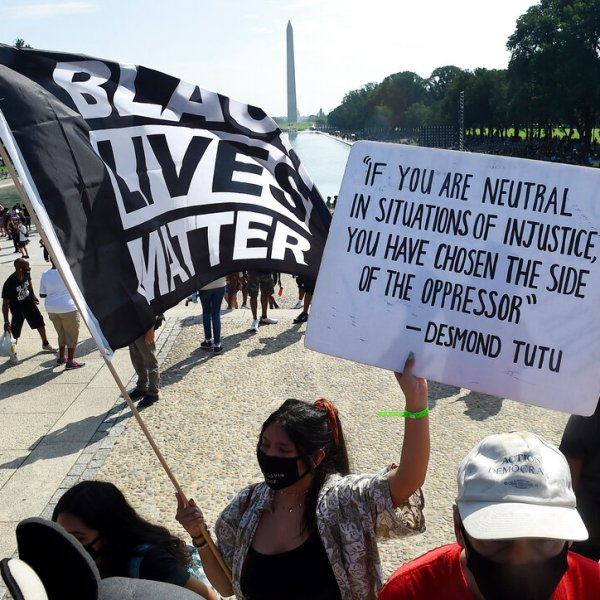 """In this Aug. 28, 2020, file photo, demonstrators gather near the Lincoln Memorial as final preparations are made for the March on Washington, in Washington, on the 57th anniversary of the Rev. Martin Luther King Jr.'s """"I Have A Dream"""" speech. Several years since its founding, BLM has evolved well beyond the initial aspirations of its early supporters. Now, its influence faces a test, as voters in the Tuesday, Nov. 3 general election choose or reject candidates who endorsed or denounced the BLM movement amid a national reckoning on race (Olivier Douliery/Pool Photo via AP, File)"""