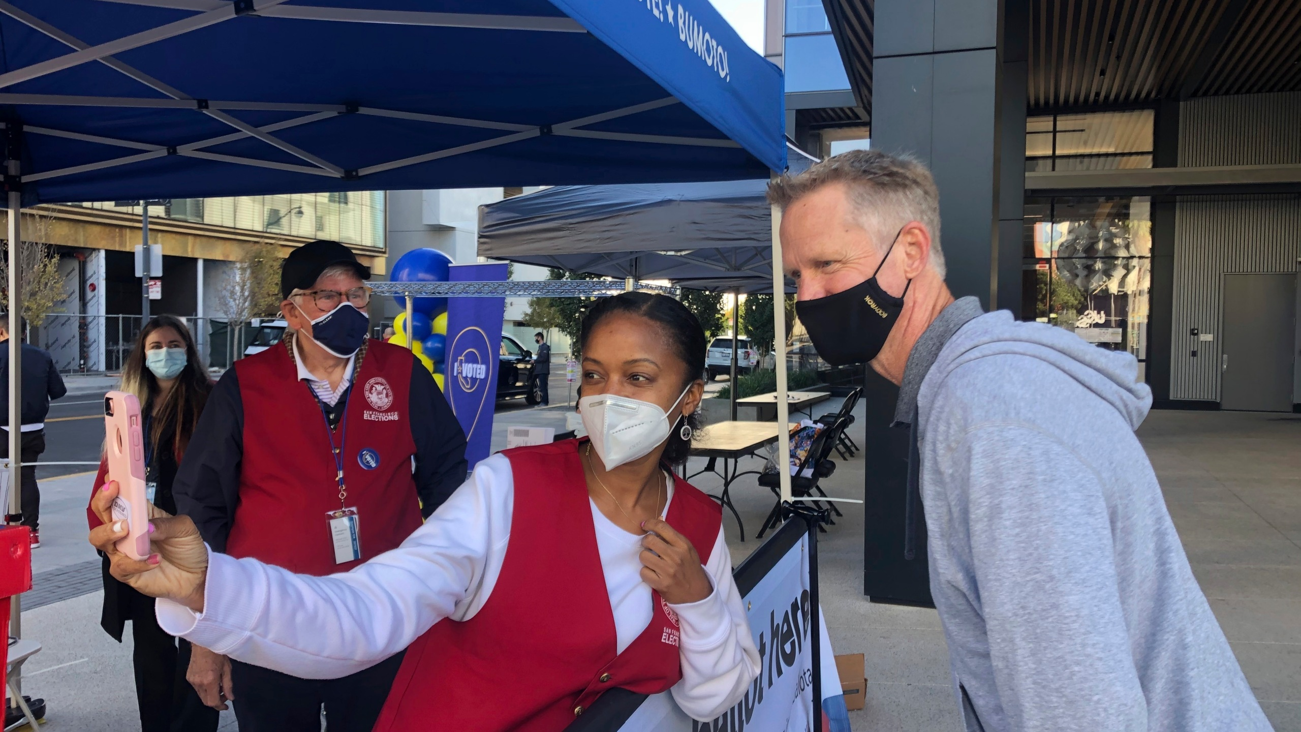 Golden State Warriors coach Steve Kerr poses for a selfie with voting worker Jujuana Williams of Oakland on Saturday, Oct. 31, in San Francisco. (Janie McCauley/AP Photo)
