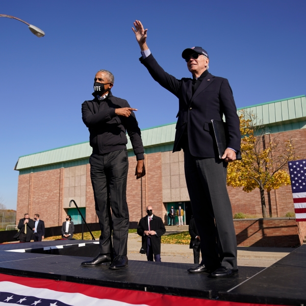 Democratic presidential candidate former Vice President Joe Biden, right, and former President Barack Obama greet each other at a rally at Northwestern High School in Flint, Mich., Saturday, Oct. 31, 2020. (AP Photo/Andrew Harnik)