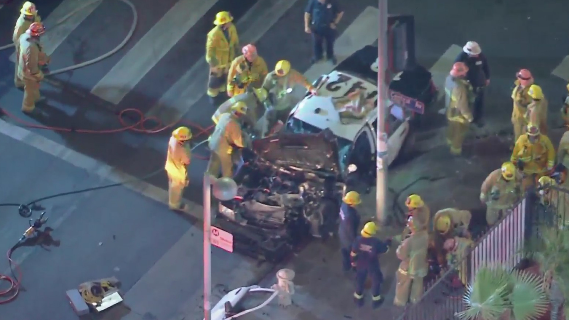 First responders work at the scene of a South Los Angeles crash involved a Los Angeles police car carrying two officers on Oct. 21, 2020. (KTLA)