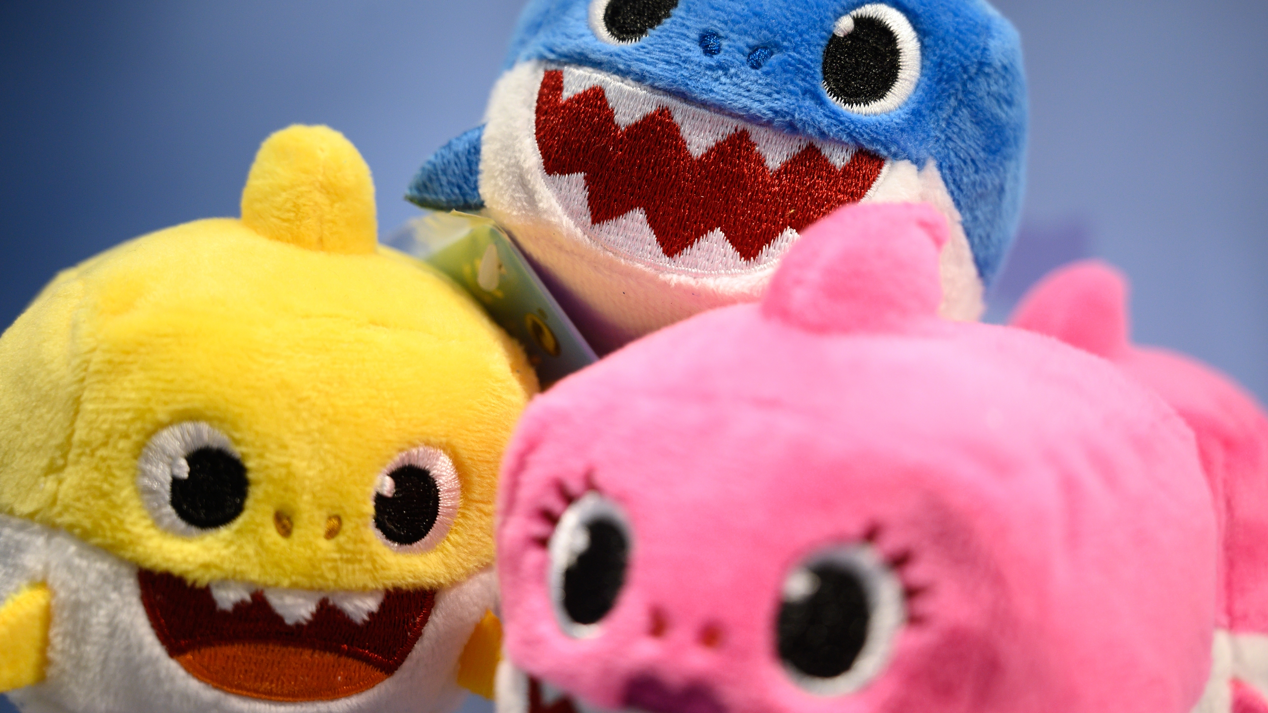 "A selection of ""Baby Shark"" toys are seen on a display at the annual ""Toy Fair"" at Olympia London on January 22, 2019 in London, England. (Leon Neal/Getty Images)"