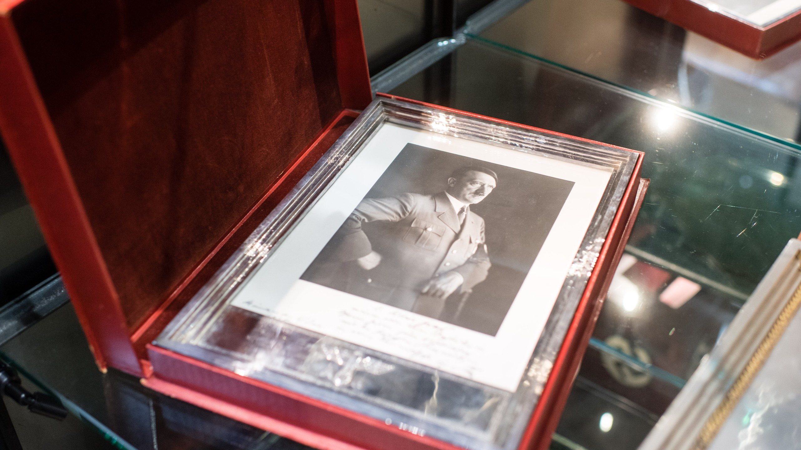 A framed portrait of Adolf Hitler is pictured on Nov. 20, 2019 at the Hermann Historica auction house in Grasbrunn near Munich, southern Germany, prior to an auction of personal belongings from German dictator Adolf Hitler and other notorious World War II Nazi leaders. (MATTHIAS BALK/dpa/AFP via Getty Images)