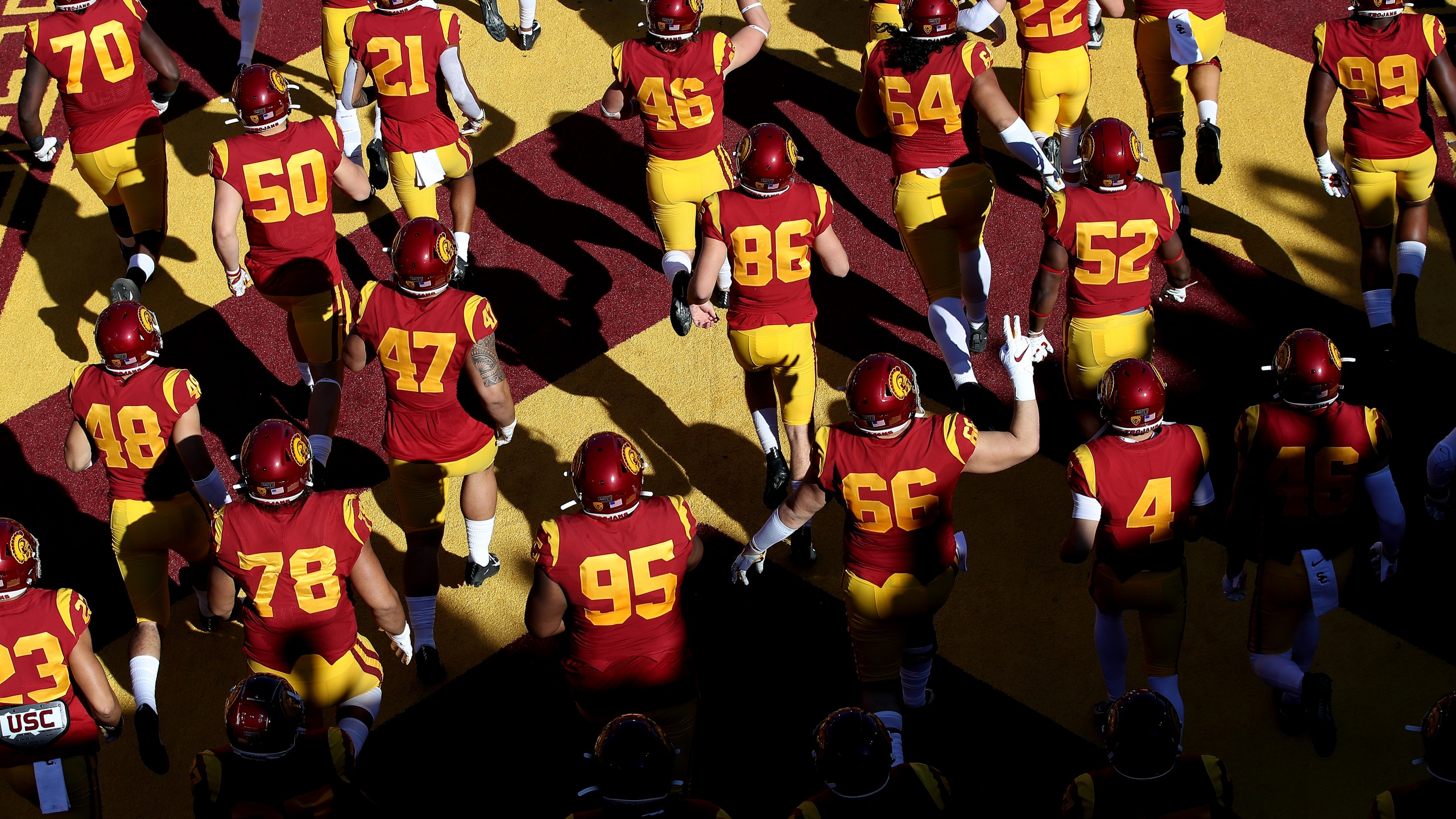 The USC Trojans run onto the field prior to a game against the UCLA Bruins at Los Angeles Memorial Coliseum on Nov. 23, 2019, in Los Angeles. (Sean M. Haffey/Getty Images)