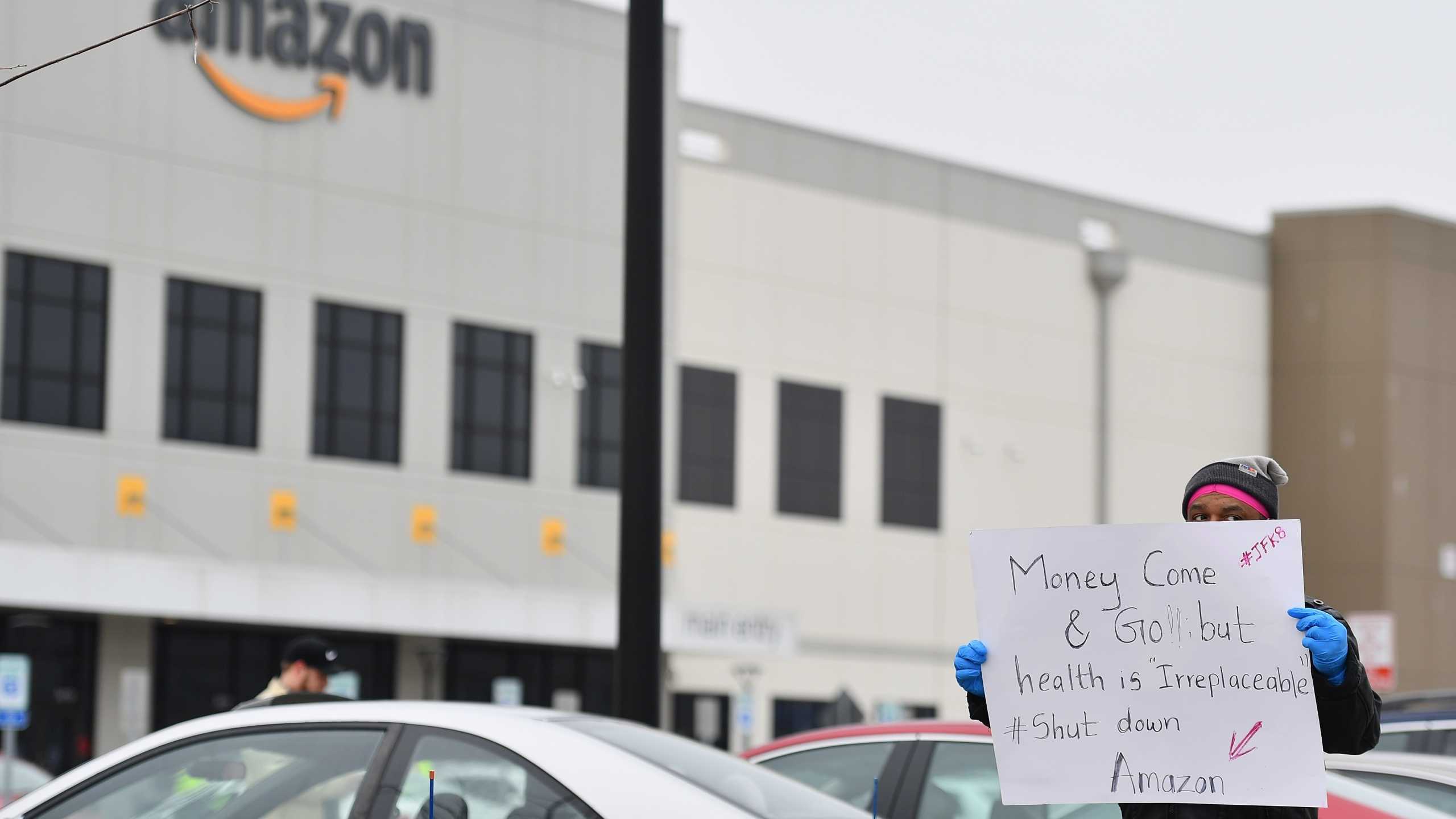 Workers at Amazon's Staten Island warehouse strike in demand that the facility be shut down and cleaned after one staffer tested positive for the coronavirus on March 30, 2020. (Angela Weiss / AFP / Getty Images)