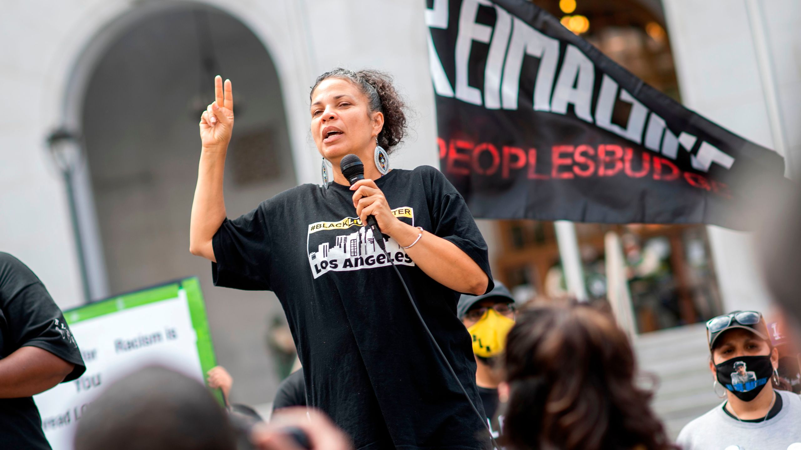 Melina Abdullah from Black Lives Matter addresses the crowd during a demonstration to ask for the removal of District Attorney Jackie Lacey in front of the Hall of Justice, in Los Angeles on June 17, 2020. (Valerie Macon/AFP via Getty Images)