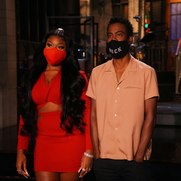 """Musical guest Megan Thee Stallion and host Chris Rock appears in a promo for """"Saturday Night Live"""" in October 2020. (Rosalind O'Connor/NBC/NBCU Photo Bank via Getty Images)"""