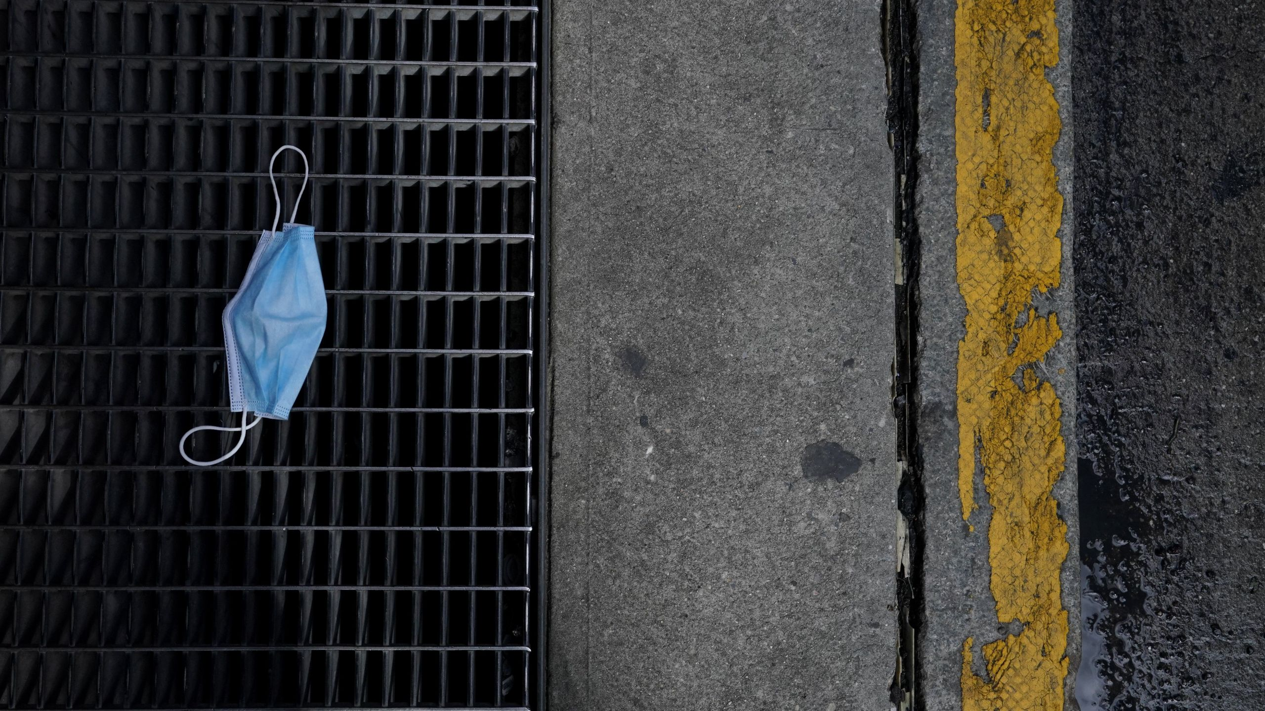 This file photo shows a discarded surgical mask on the ground of Lexington Avenue in the Upper East Side of New York on Oct. 2, 2020. (TIMOTHY A. CLARY/AFP via Getty Images)
