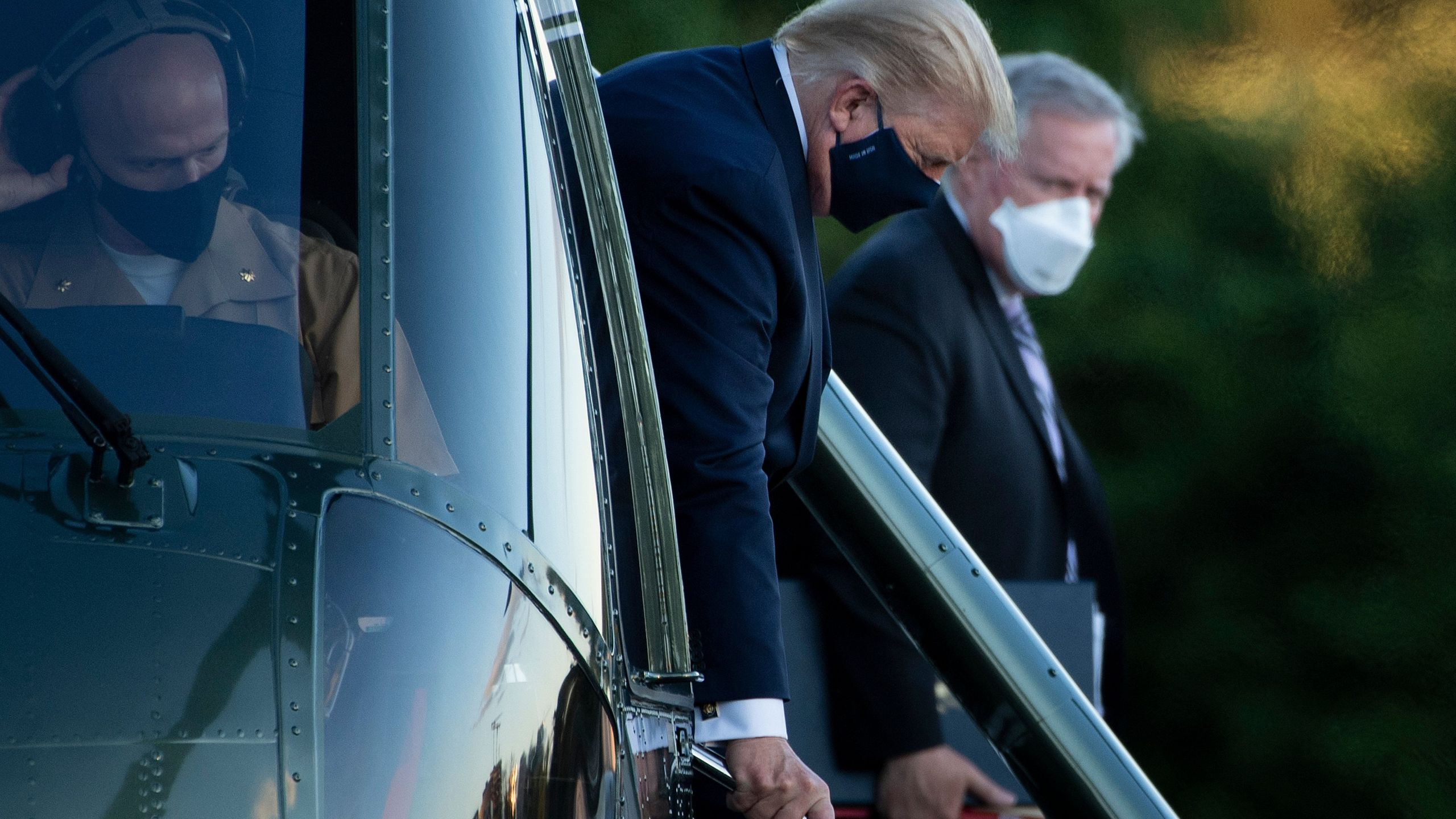 White House Chief of Staff Mark Meadows (R) watches as US President Donald Trump walks off Marine One while arriving at Walter Reed Medical Center in Bethesda, Maryland on Oct. 2, 2020. (BRENDAN SMIALOWSKI/AFP via Getty Images)