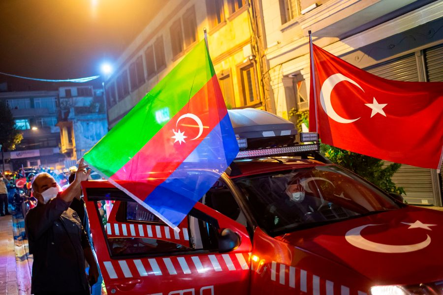 Members of Turkey's Humanitarian Relief Foundation (IHH) display Turkish and Azerbaijan flags on their vehicle before taking a tour in the city in solidarity with Azerbaijan, in Istanbul on Oct. 5, 2020. (YASIN AKGUL/AFP via Getty Images)