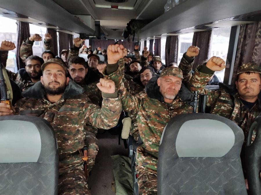 Ethnic Armenian volunteers and reservists ride in a bus towards the Karabakh frontline to fight with Azeri troops during the ongoing military conflict over the breakaway Nagorno-Karabakh region on Oct. 6, 2020. (AFP via Getty Images)