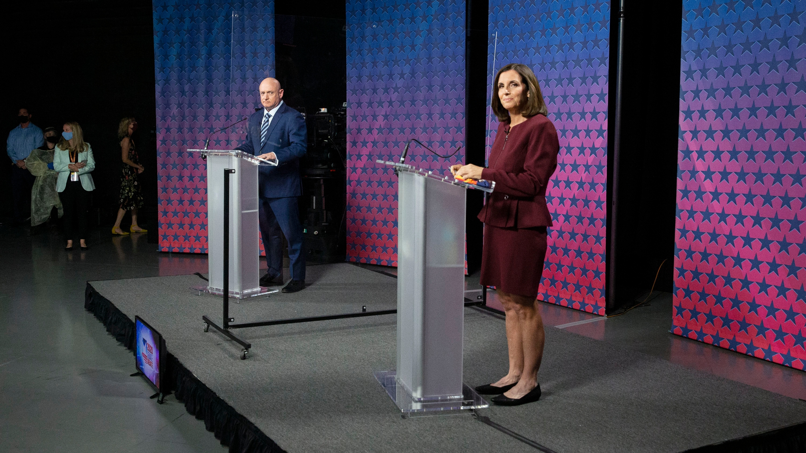 U.S. Senator Martha McSally (R-AZ) and Democratic challenger Mark Kelly are separated by plexiglass as they participate in a debate at the Walter Cronkite School of Journalism at Arizona State University in Phoenix, Arizona, on October 6, 2020. (Photo by Rob SCHUMACHER / POOL / AFP) (Photo by ROB SCHUMACHER/POOL/AFP via Getty Images)