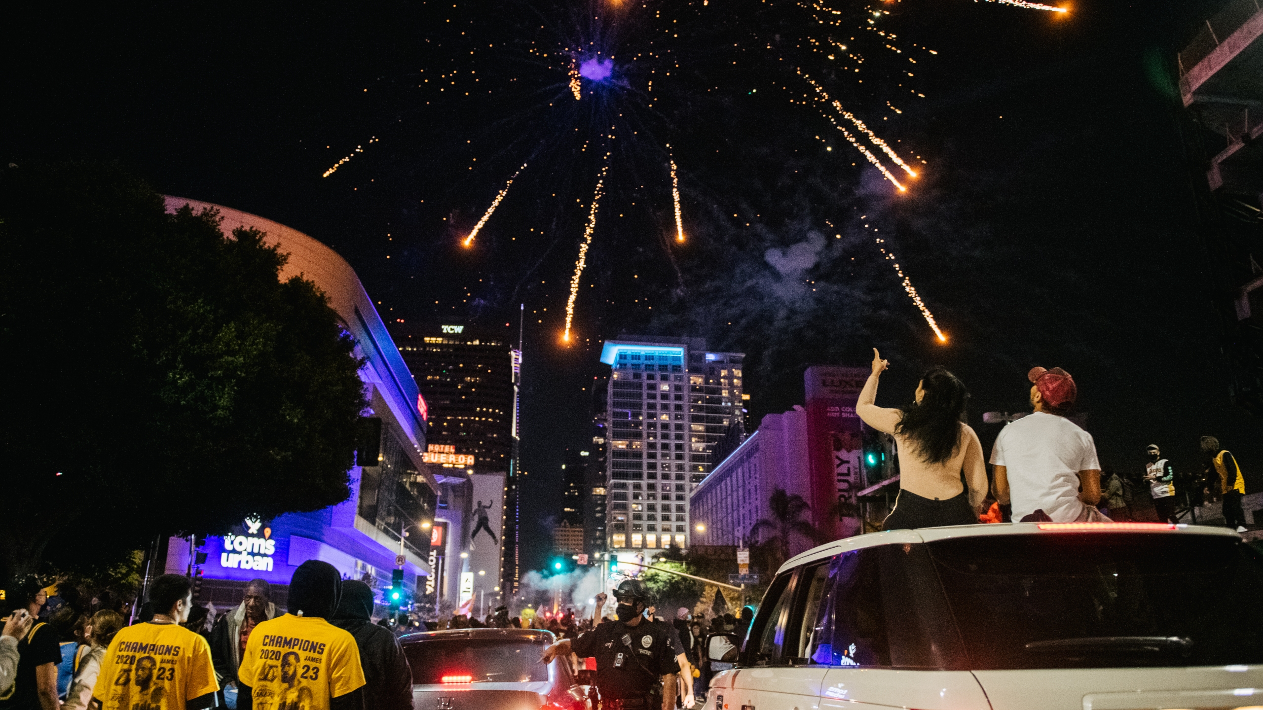 Lakers fans celebrate in front of the Staples Center on Oct. 11, 2020 in Los Angeles. (Brandon Bell/Getty Images)