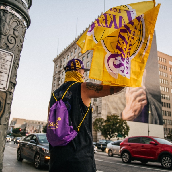 A man sells Lakers merchandise outside of the Staples Center on Oct. 11, 2020 in Los Angeles. (Brandon Bell/Getty Images)