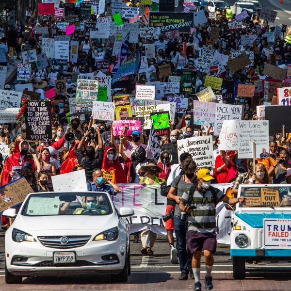 Demonstrate make their way through Los Angeles for the Women's March on Oct. 17, 2020. (APU GOMES/AFP via Getty Images)
