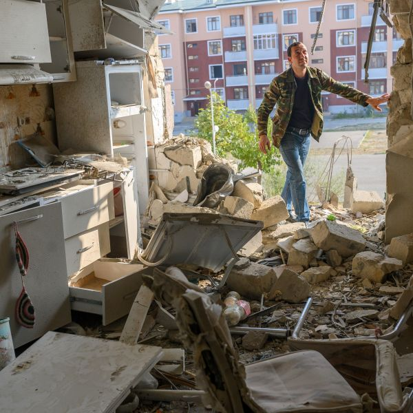 Movsumov Qowkar, 32, checks his neighbor's flat damaged during fighting over the breakaway region of Nagorno-Karabakh, in the city of Terter early on Oct. 18, 2020. The origins of a flareup in fighting over Nagorno-Karabakh that has now killed hundreds and threatens to involve regional powers Turkey and Russia are hotly contested and difficult to independently verify. Both sides accuse the other of striking first on September 27 over the ethnic Armenian region of Azerbaijan. (BULENT KILIC /AFP via Getty Images)