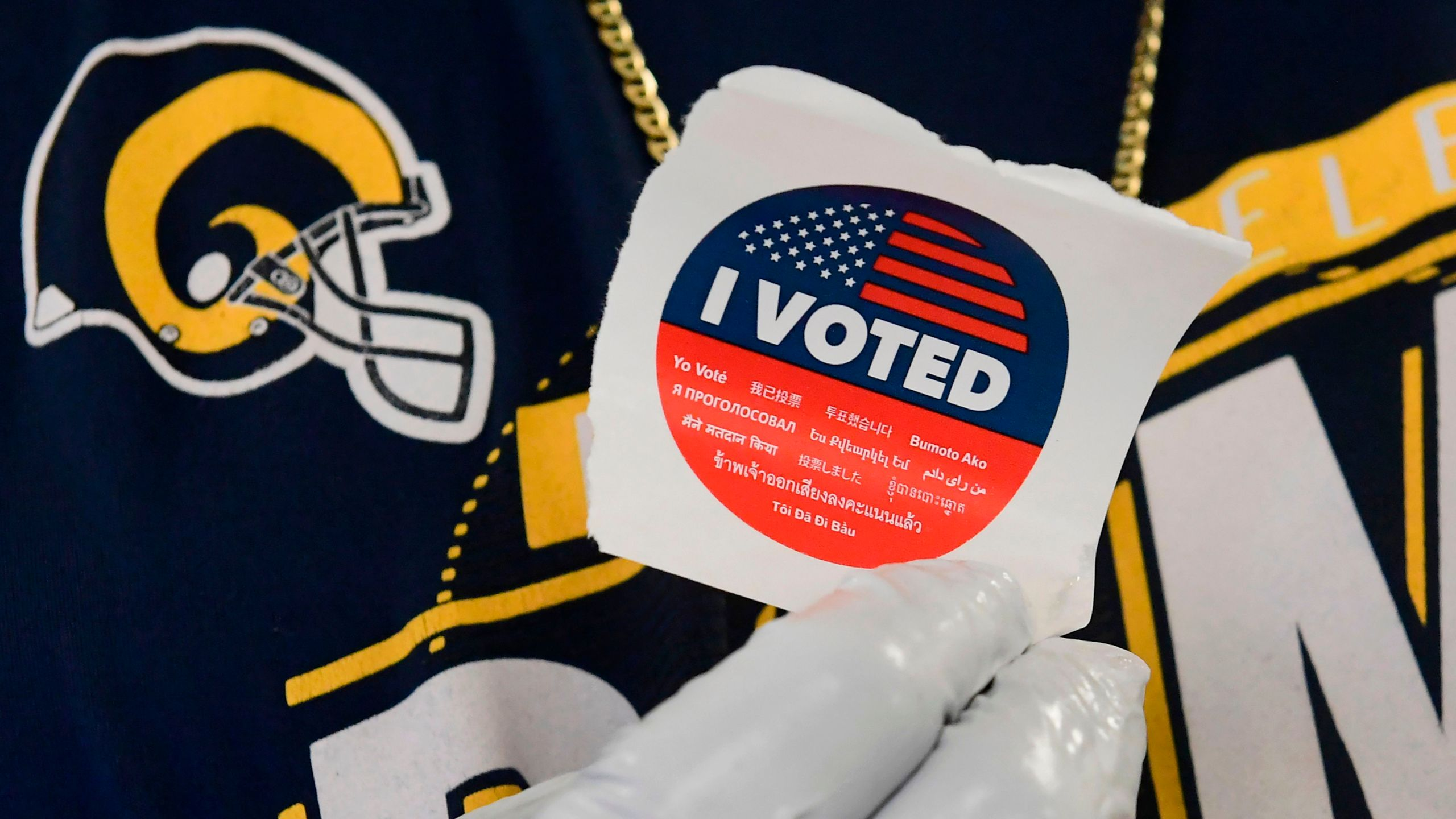 "A voter displays his ""I voted"" sticker after casting a ballot in the 2020 presidential election at the Los Angeles County Registrar's Office in Norwalk on Oct. 19, 2020.(Frederic J. Brown / AFP / Getty Images)"