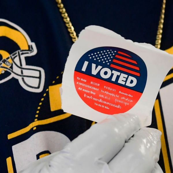 """A voter displays his """"I voted"""" sticker after casting a ballot in the 2020 presidential election at the Los Angeles County Registrar's Office in Norwalk on Oct. 19, 2020.(Frederic J. Brown / AFP / Getty Images)"""