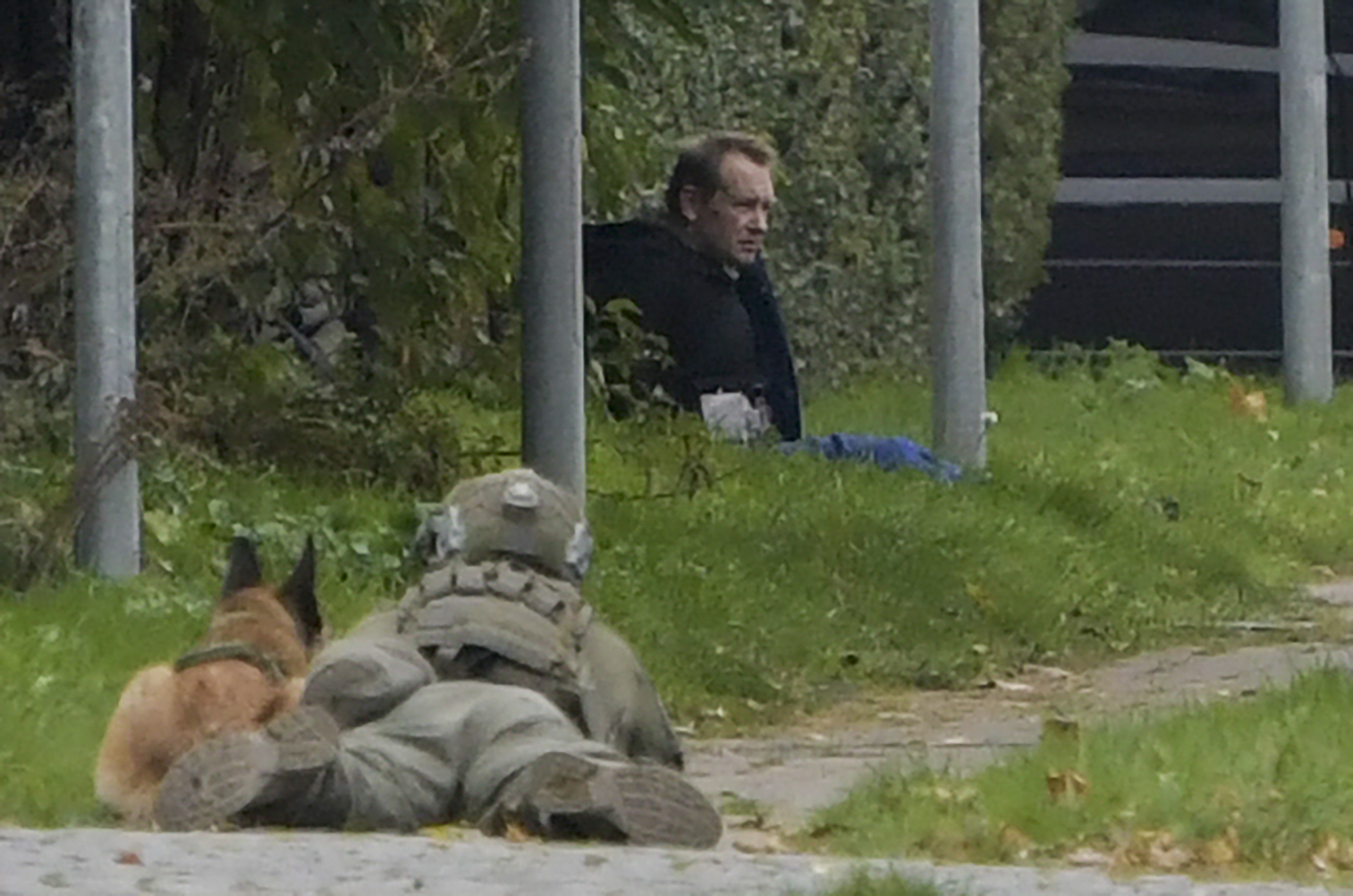 A police marksman and his dog observes convicted killer Peter Madsen threatening police with detonating a bomb while attempting to break out of jail in Albertslund, Denmark on Oct. 20, 2020. (NILS MEILVANG/Ritzau Scanpix/AFP via Getty Images)