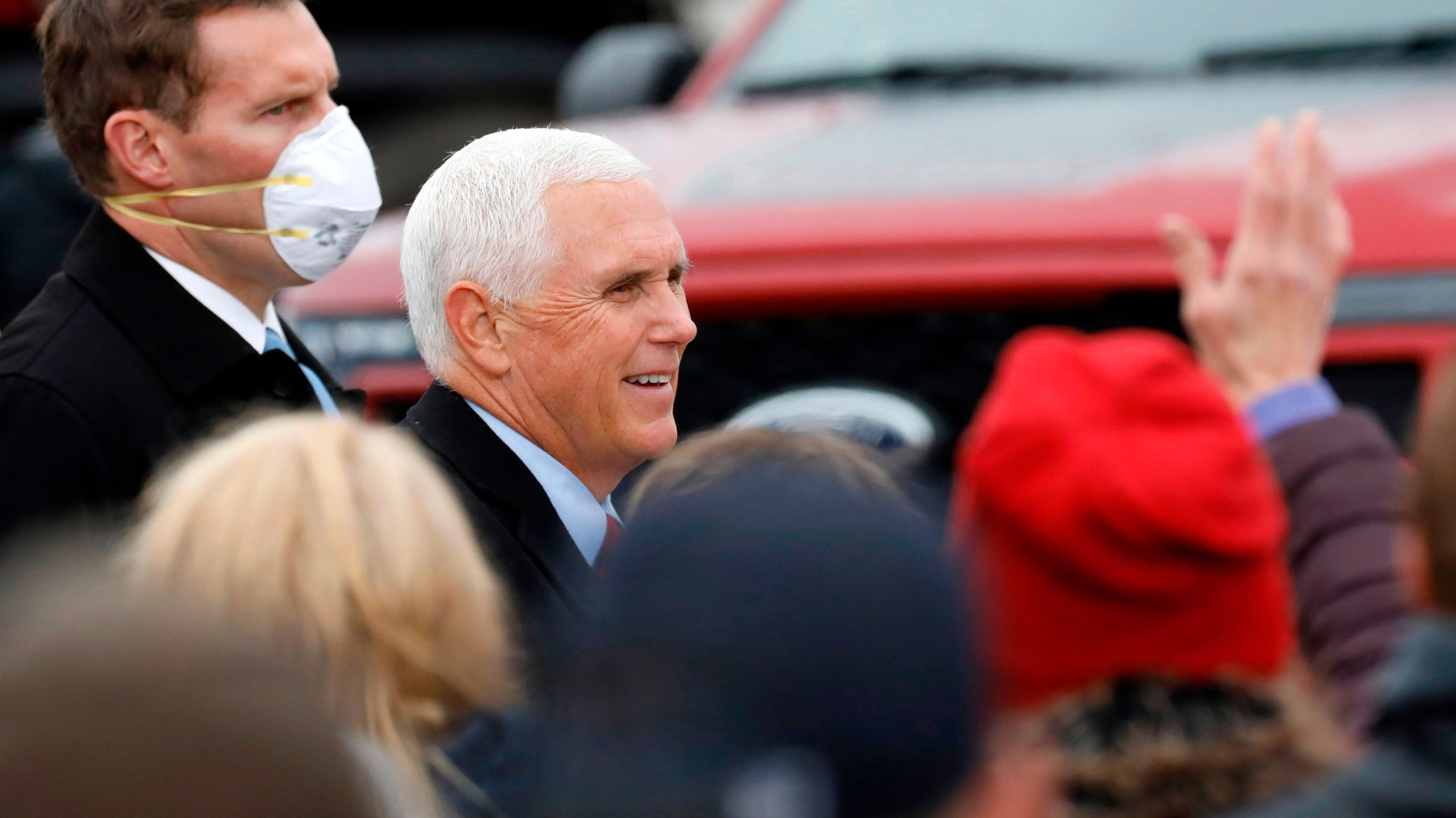 "Vice President Mike Pence greets supporters after his ""Make America Great Again!"" campaign event at Oakland County International Airport in Waterford, Michigan, on Oct. 22, 2020. (JEFF KOWALSKY/AFP via Getty Images)"