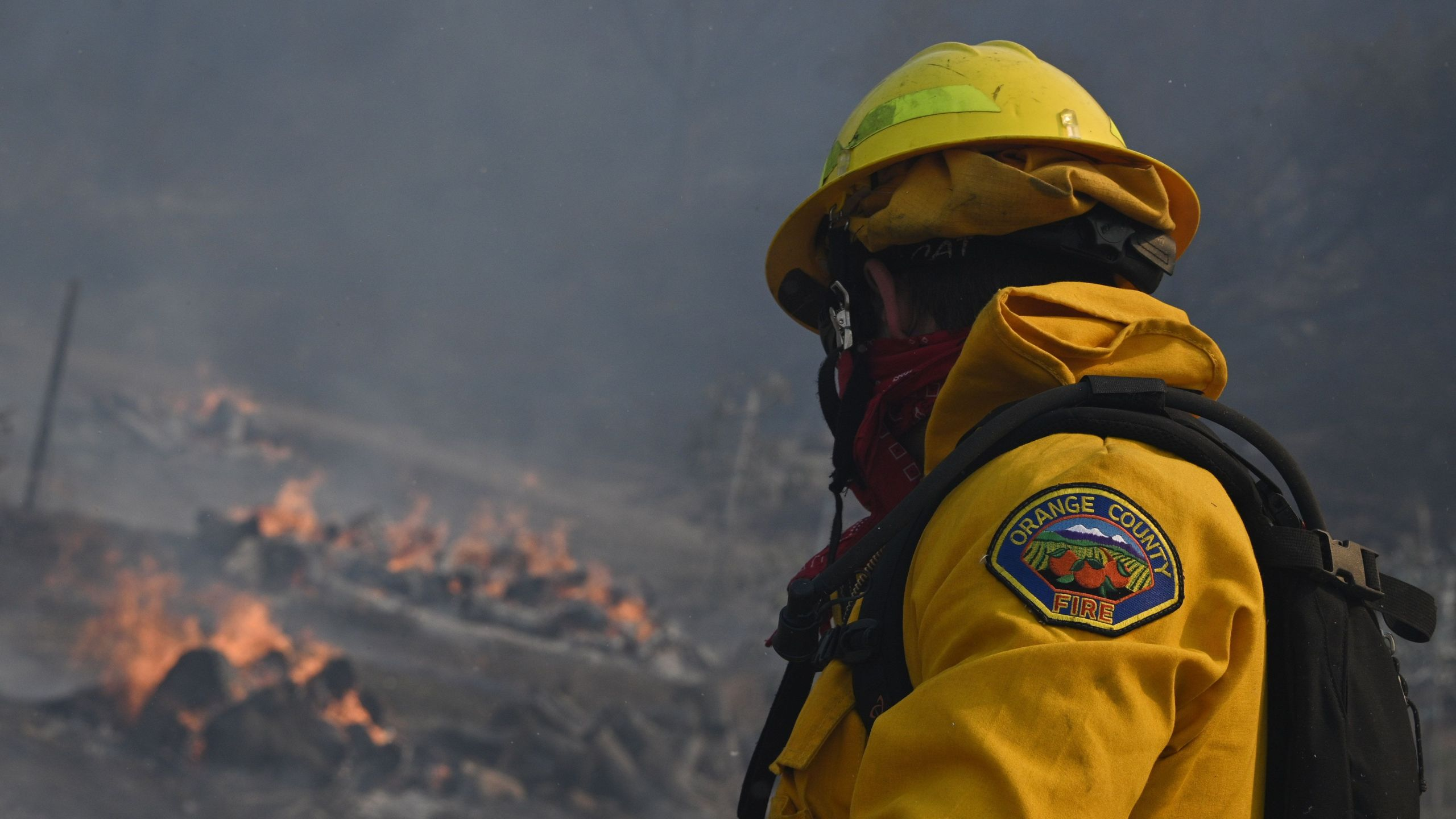 An Orange County firefighter looks for hotspots near a residential area in the Silverado Fire October 26, 2020 in Irvine, California. (ROBYN BECK/AFP via Getty Images)
