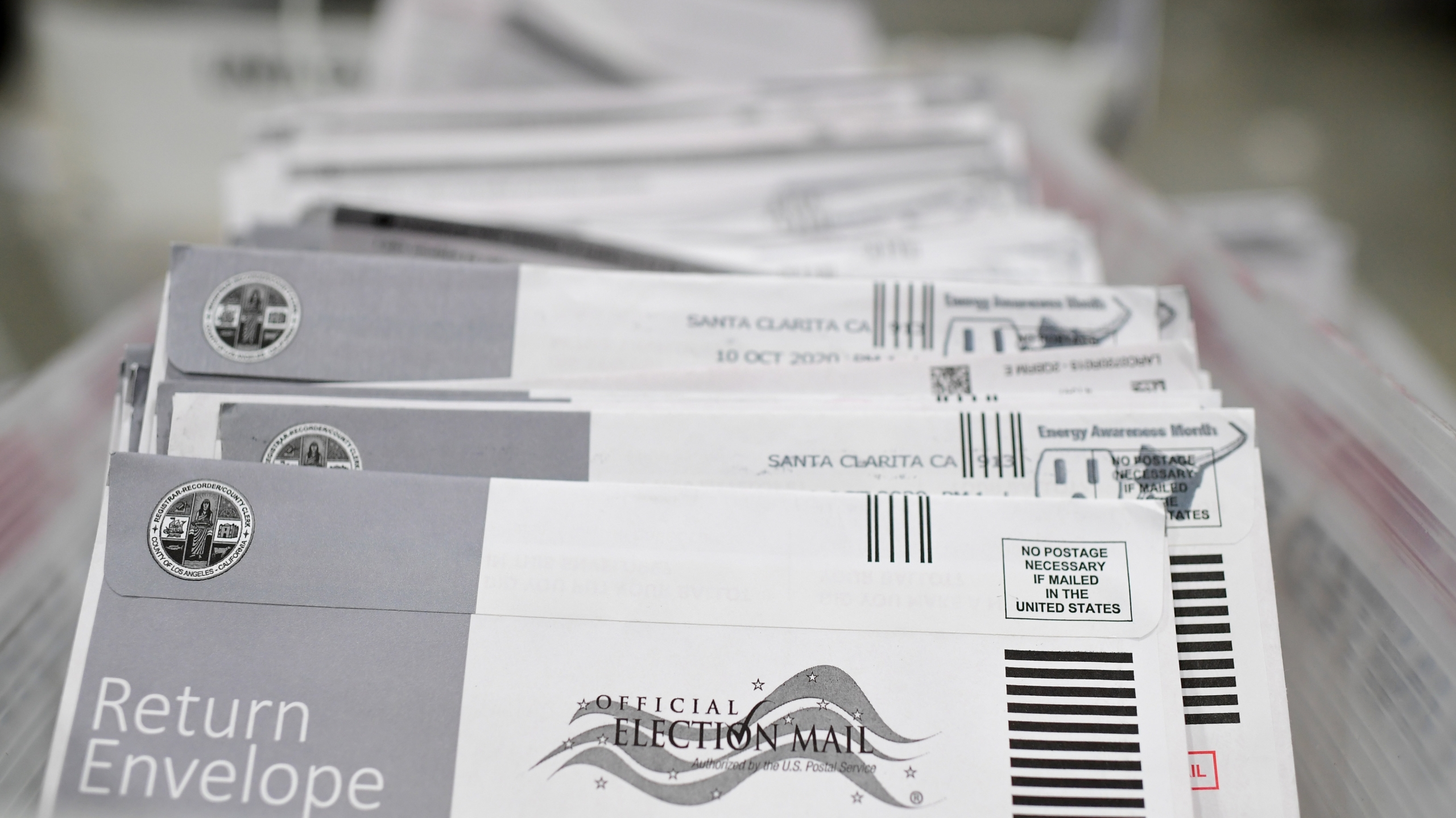 Mail-in ballots in their envelopes await processing at the Los Angeles County Registrar Recorders' mail-in ballot processing center at the Pomona Fairplex on Oct. 28, 2020. (Robyn Beck / AFP / Getty Images)