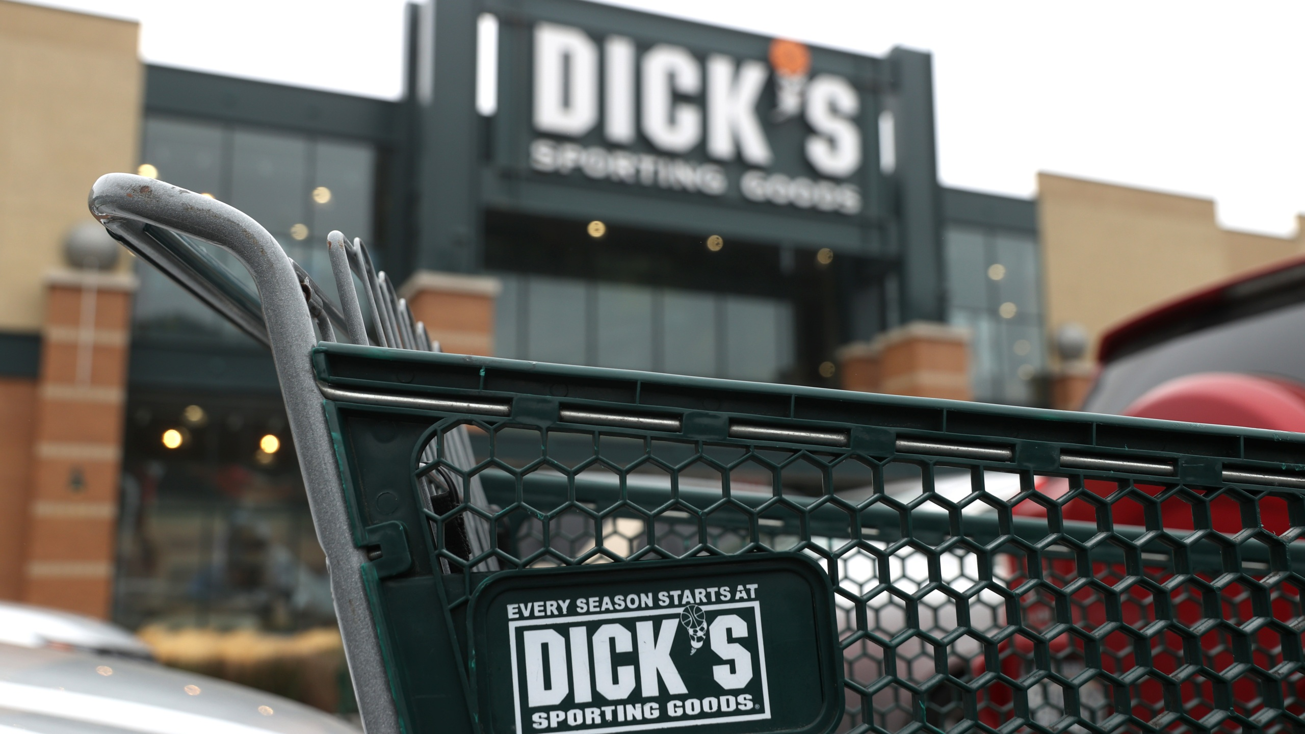 A shopping cart sits in front of a Dick's Sporting Goods store on Aug. 26, 2020. in Daly City, California. (Justin Sullivan/Getty Images)